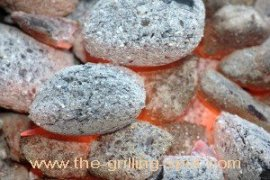 Hot Glowing ashy-gray briquettes