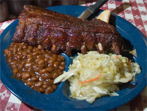 Plate with ribs, beans, and slaw
